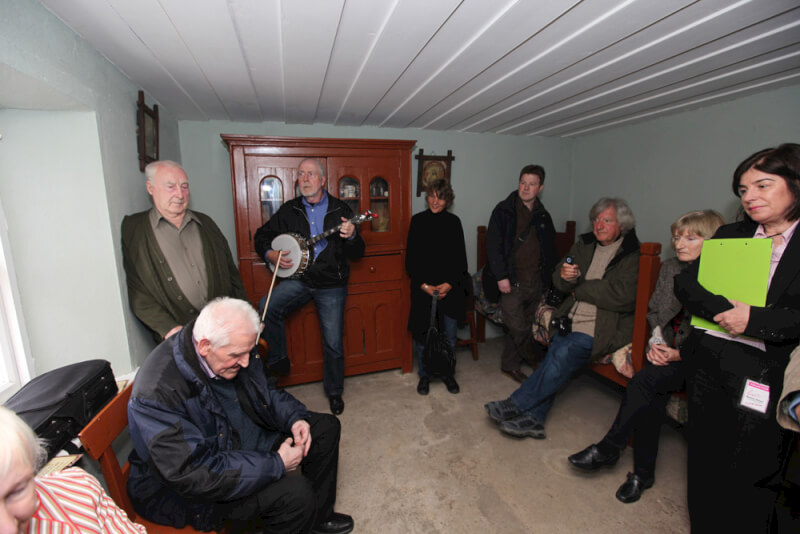 Denis McGowan singing at music session in Seán MacDiarmada's house Kiltyclogher